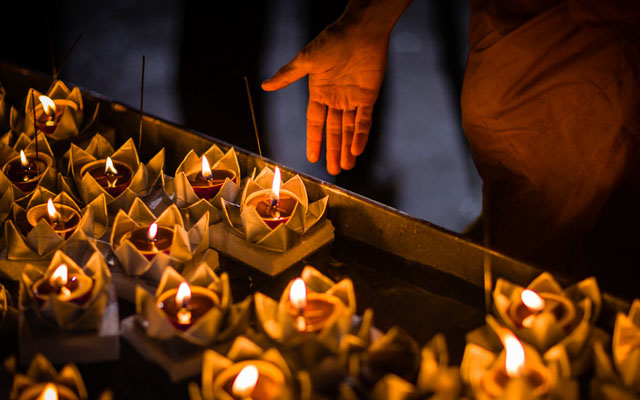 Candles are floated as offerings during the Thai Buddhist festival of Loy Krathong in Bangkok, Thailand.