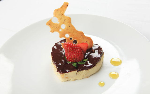 Almond ricotta cream with chocolate glazing, orange blossom honey, Cognac and fresh strawberry 2