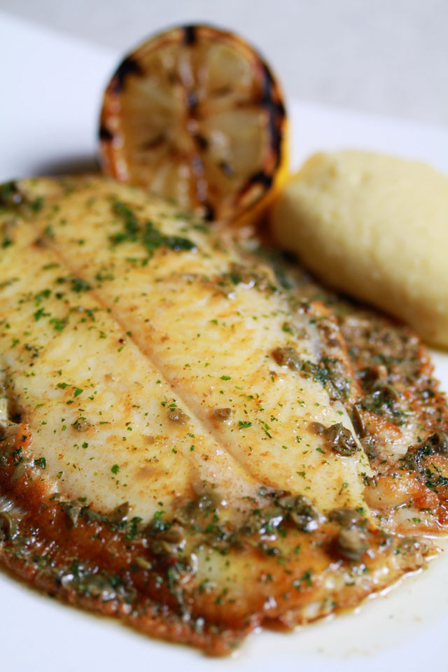 Whole fresh Atlantic lemon sole pan-fried in Echire butter and flat parsley