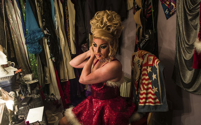 Zoe, host of the Funny Girls drag revue bar, prepares for a Christmas show. The venue has been a pop
