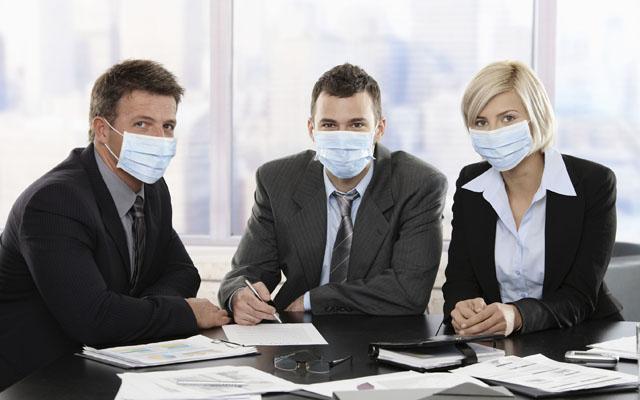 Business people fearing swineflu virus