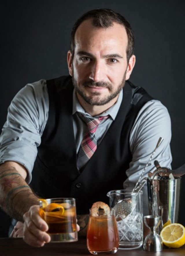 "CHARLES JOLY WORLD CLASS BARTENDER OF 2014 Chicago native Charles Joly is an award-winning, lifelong food and beverage professional.In 2014 he beat a field of 48 mixologists from throughout the globe and was named the Diageo World Class Bartender of the Year for 2014, becoming the first American ever to receive this honour.   His other achievements include the World's Best Cocktail Menu - Tales of the Cocktail 2014, James Beard Award 2013 for Outstanding Beverage Programmeand being named the Best Bartender in America on NBC ""On the Rocks"". Charles likes to put his unique twist to classic cocktails and is famous for his attention to details. Apart from being a cocktail creator, Charles is also a tasting judge for the San Francisco World Spirits Competition and a founder of Crafthouse Cocktails. He is an avid traveller and shares his passion for cocktails everywhere he goes."