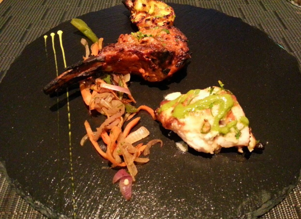 Tandoori Jheenga (tiger prawns scented with carom seed and char-grilled in a tandoori oven, served with mint and coriander chutney)